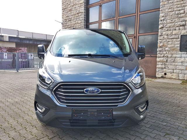 Ford Tourneo Custom - L2 TitaniumX mHEV 185 8 Sitz Klima Vor+Hint PDC Temp SHZ LMF Kamera NAVI Xenon Leder AHK 230V