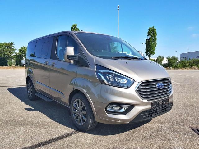 Lagerfahrzeug Ford Tourneo Custom - L1 TitaniumX mHEV 185 8 Sitz Klima Vor Hint PDC Temp SHZ LMF Kamera NAVI Xenon Leder AHK 230V