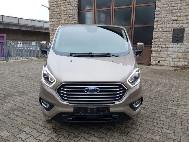 Ford Tourneo Custom - L1 TitaniumX mHEV 185 8 Sitz Klima Vor+Hint PDC Temp SHZ LMF Kamera NAVI Xenon Leder AHK 230V