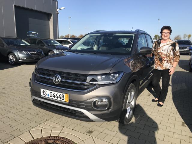 Uebergabe an Kunde Braun VW T-Cross Reimport guenstig kaufen