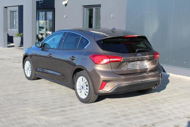 Ford Focus 4-Türer - 1.0 EcoBoost 125 PS Titanium-5 Jahre Garantie-Navi-Klimaautomatik-Winterpaket-PDC Vu.H-Bluetooth-Top Sofort