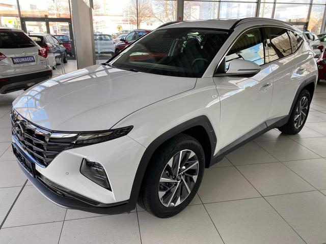 Vorlauffahrzeug Hyundai Tucson - Style 2021 1.6 T-GDI Mildhybrid  7AT 4WD P.Dach LED El. Heckk. Smartkey Navi Klimaauto Krell SHZ V H PDC R.Cam Temp