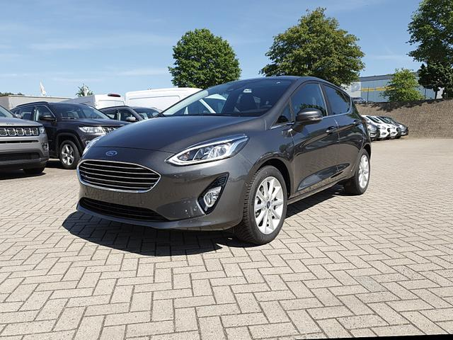 Ford Fiesta - 1.0 100PS EcoBoost Titanium 5-türig Klimaautomatik abged.Scheiben Frontscheibe beheizb. Navi PDC v+h Rückf.Kamera