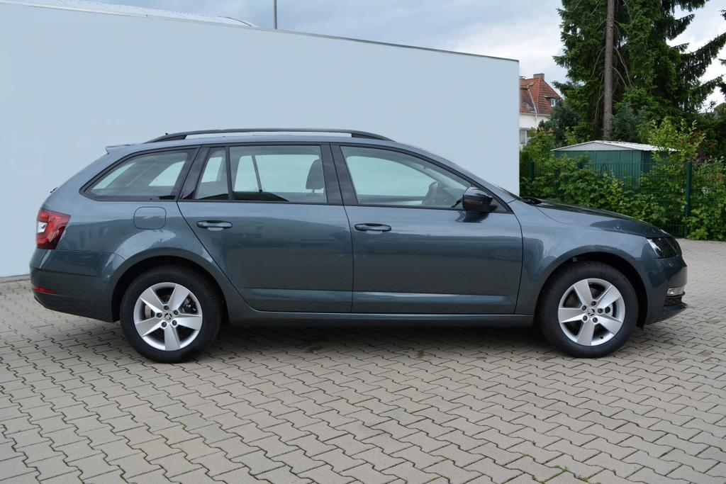 skoda octavia combi ambition 1 6tdi dsg klimaautomatik pdc vorne hinten alu radio bolero. Black Bedroom Furniture Sets. Home Design Ideas